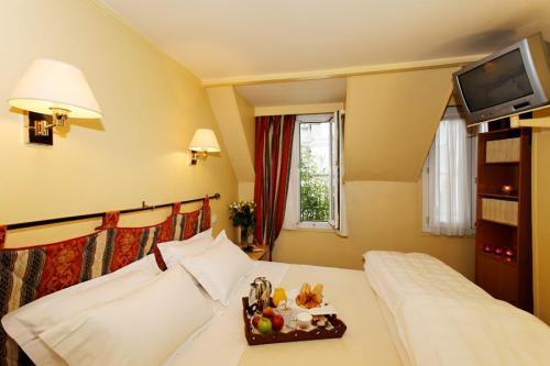 Petit madeleine h tel hotel paris null prix for Reservation hotel paris pas cher